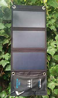 hanging folding solar panel charger blitzwolf in a tree