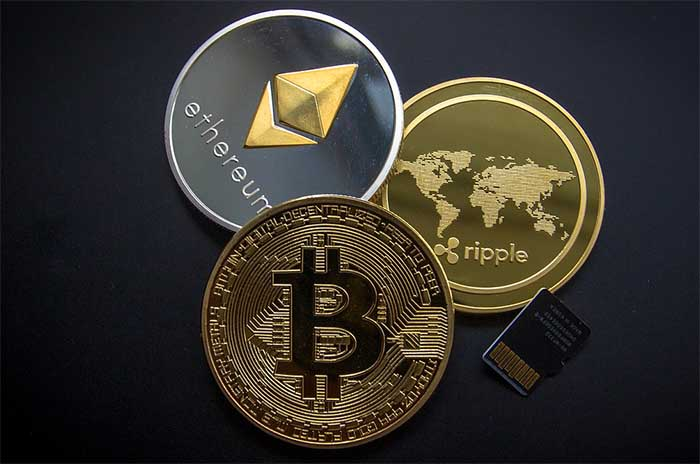 Physical cryptocurrency coins XRP Ripple, Bitcoin, Litecoin