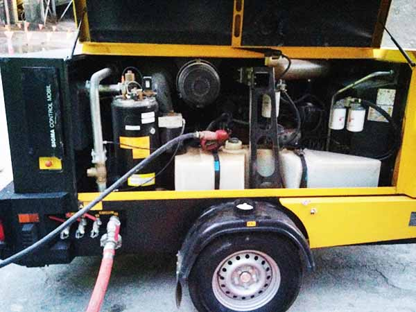 filling up an air-compressor with diesel using a 12v high flow portable fuel transfer pump