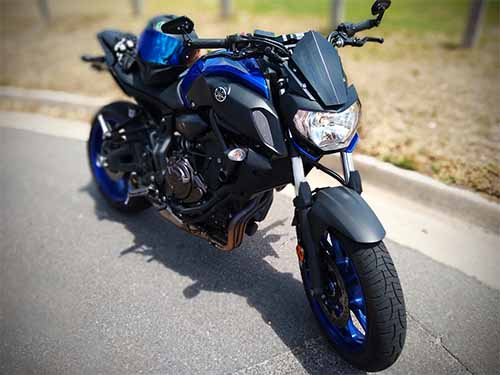 Yamaha MT07 with black helmet on seat Weight Reduction Project