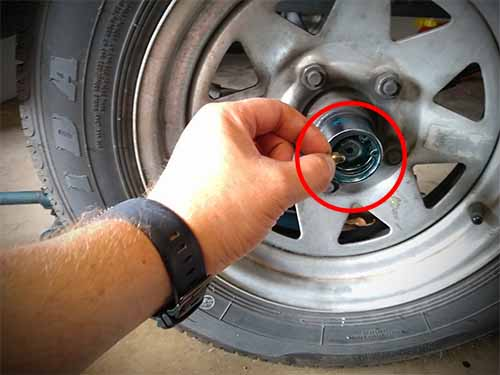 How to unclog grease fitting on bearing buddy